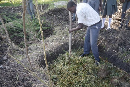 Students making their compost pile