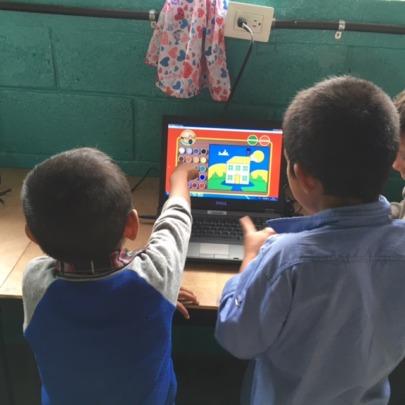 Students learning computer skills, Las Escobitas
