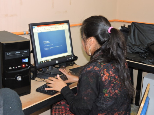 Students learning computer skills