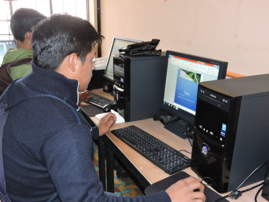 Students learning Word and Excel