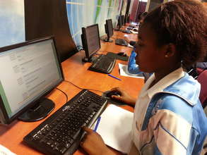 Grade 6 pupil completing her weekly online lesson