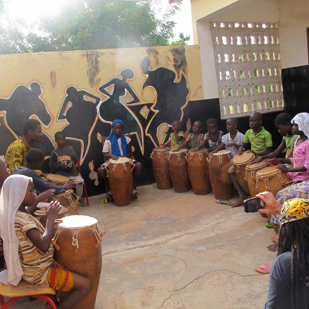 Bizung Founder, Alidu teaching a drum class