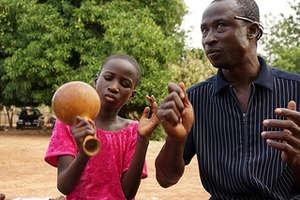 Music teacher, Ahmed Abdul-Samed gives a lesson