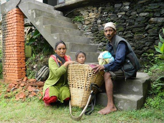 Burn patient Lukky with her parents