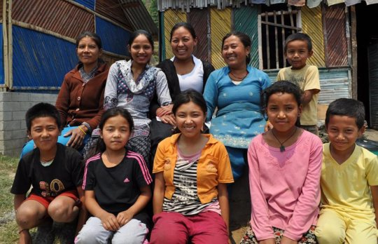 Rajbash Hospital staff with village children