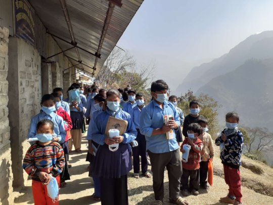 School children  with new masks and information.