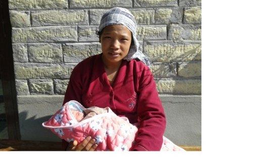 New mom Sunita with her baby girl