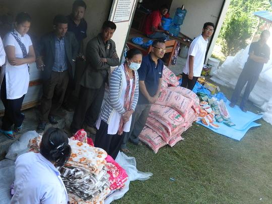 Rajbash Hospital staff distributing supplies