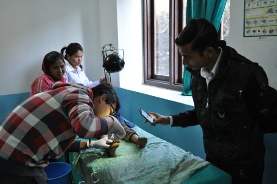 Suturing child's leg injury