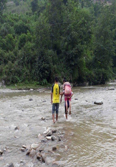 Through the river toward ambulance