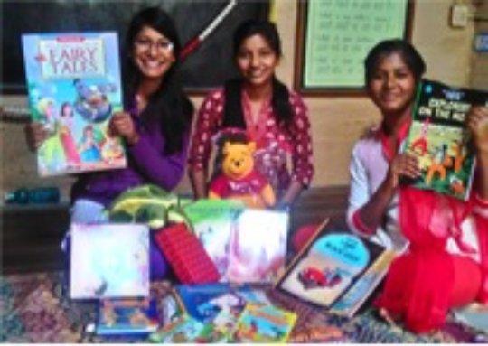 Kamla, Vimla and Deepa with books from Amazon