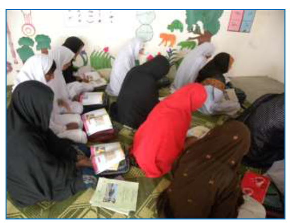 Girls in literacy class in one of the new villages