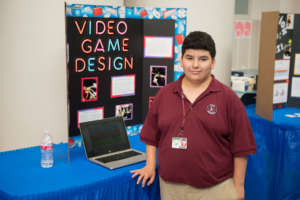 Student shows his video game design at spring WOW!