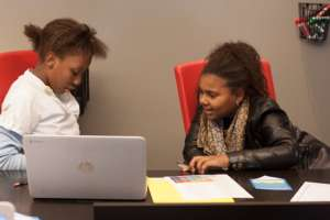 Students review their coding in an apprenticeship
