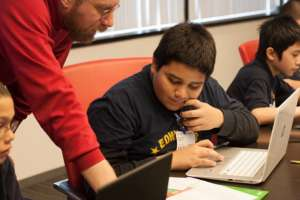 A Googler teaches a student in an apprenticeship