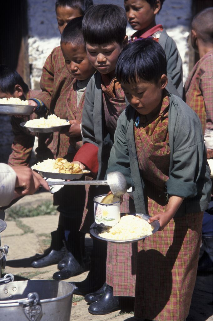 Bhutanese students receiving WFP-provided lunch in school