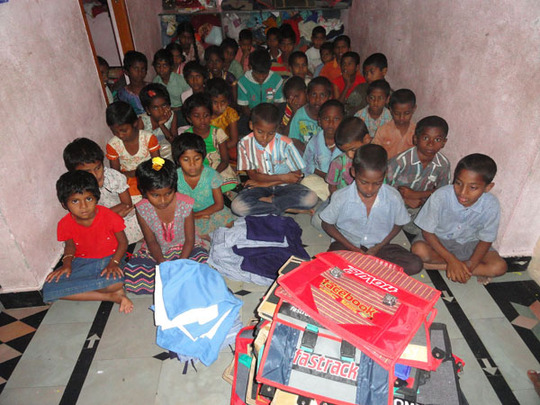 distribution of school bags to orphan children