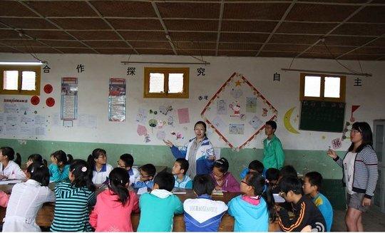 Volunteers teaching a class