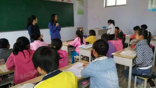 GlobalGiving staff in class with students
