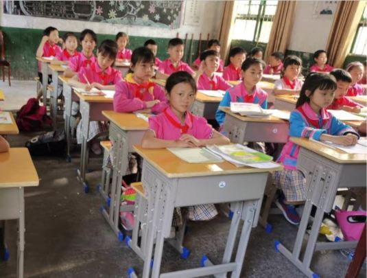 students using new desks and chairs