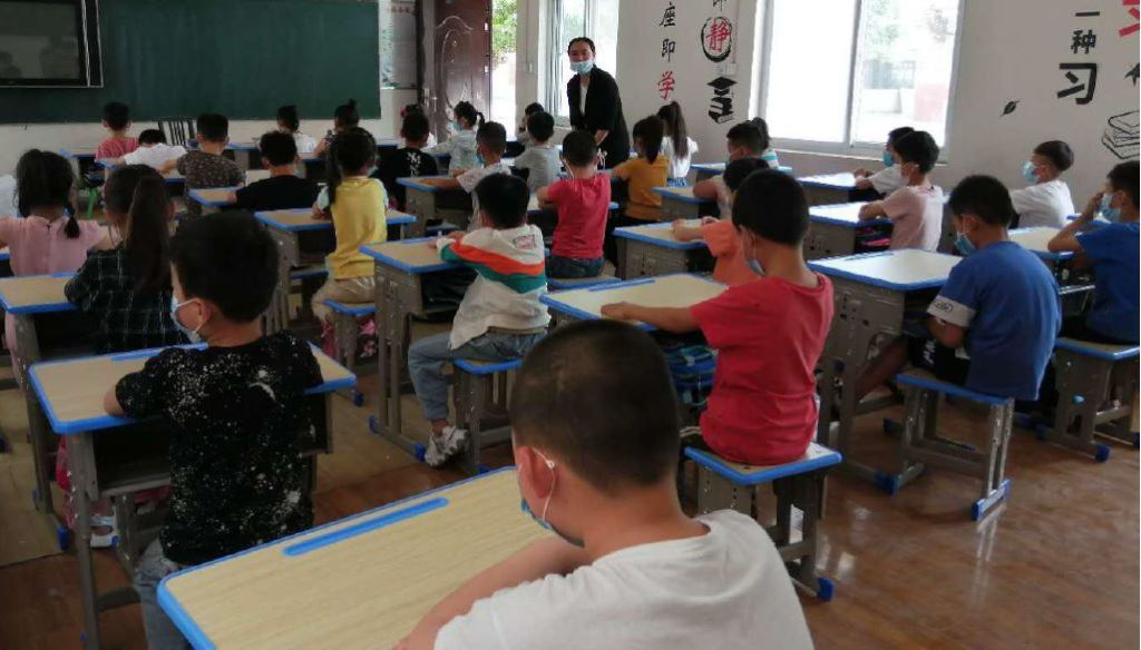 students in class with new desks and chairs
