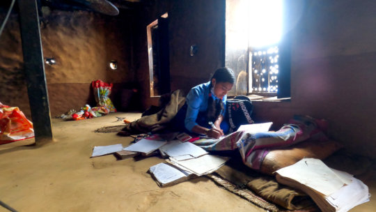 An SGT student studying in her home in Kavre,Nepal