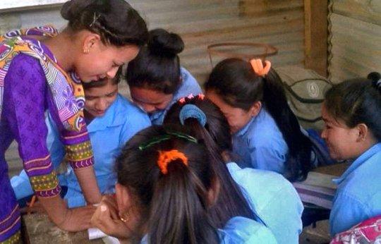 Samjhana supporting girls at the local school