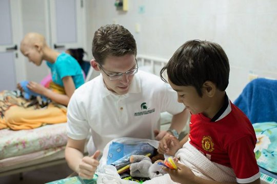 MSU medical student plays with child in oncology