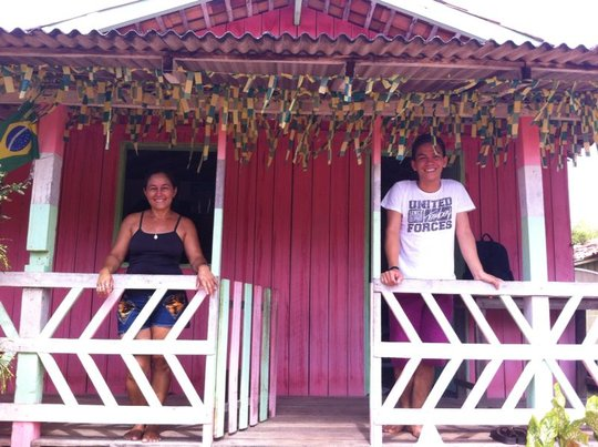 Andre and his mother at their house in Cajuuna