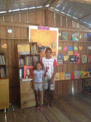 Children enjoying the library of their community