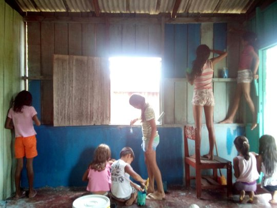 Children painting inside the library