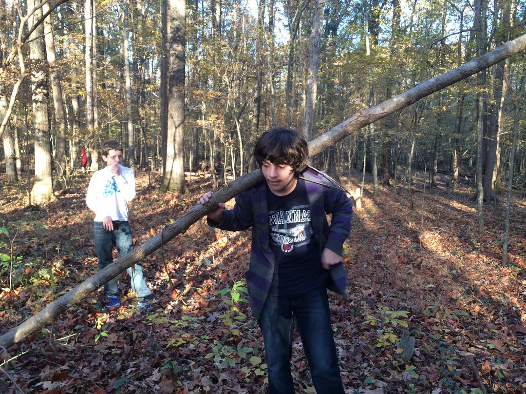 Christian with the tree he felled