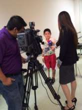Brayan sharing his brave story with reporters