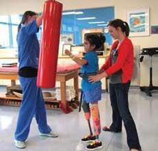 Yoaly working in the physical therapy gym