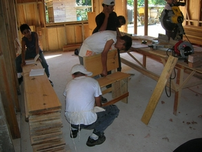 Students making benches for the school