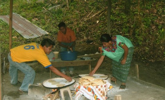Students cook meals under rustic conditions