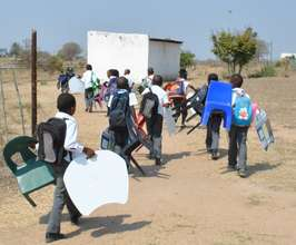 Carrying Tutudesks and chairs to school