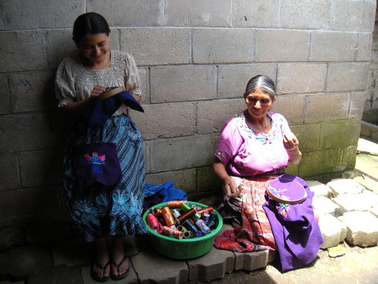 Dona Clara and her daughter make blouses to sell