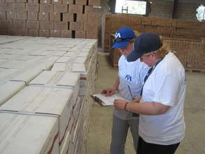 Our staff reviewing relief items at a staging area