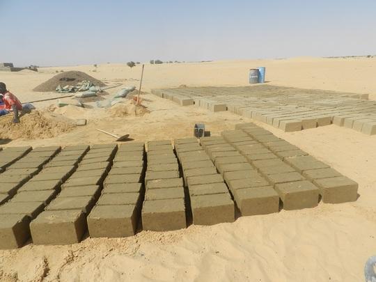 Bricks being made for school building project