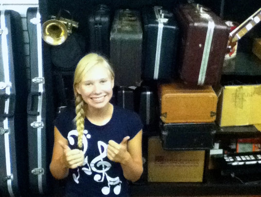 Alexia with 20 donated instruments for MHOF