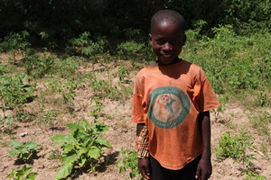 School boy in his new garden in Sisene