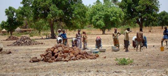 Villagers Building Rainwater Catchment Basin