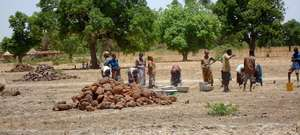 Villagers Building Rainwater Catchment Basin