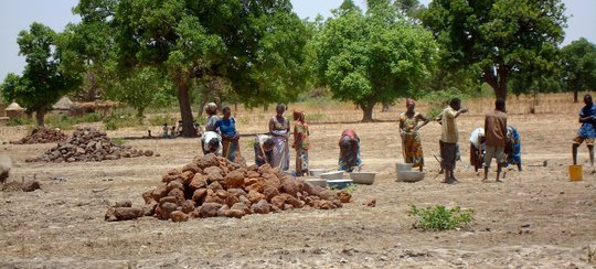Villages working at rainwater catchment basin