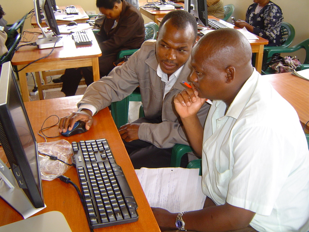 Teachers learning computer skills at the LRC