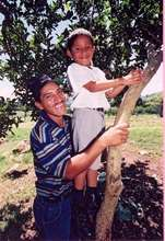 A Nicaraguan farmer and his child