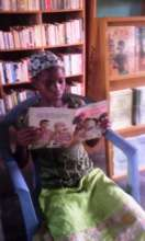 Child reads Fatou Keita in FAVL library