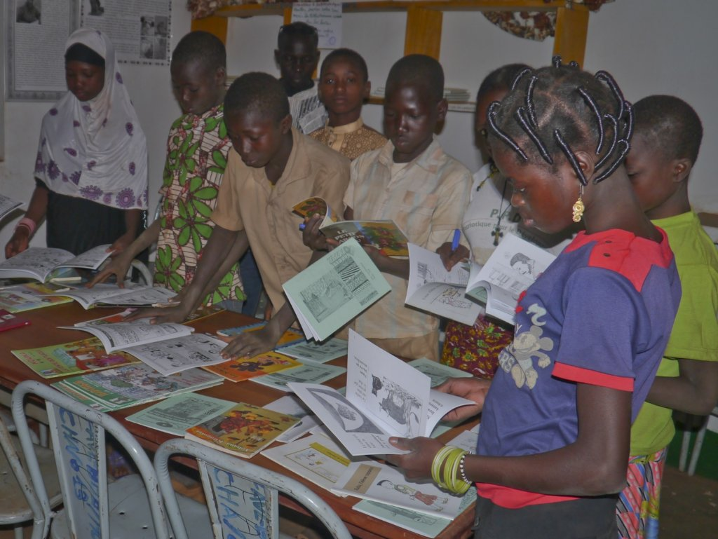 Children examine the donated books