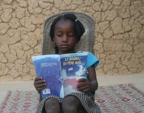 Young Reader with Fatou Keita's Christmas Book